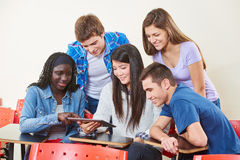Group of students with a tablet Stock Photography