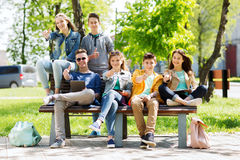 Group of students with tablet pc at school yard. Education, high school and people concept - group of happy teenage students with with tablet pc computers at Stock Photos