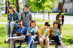 Group of students with tablet pc at school yard. Education, high school and people concept - group of happy teenage students with with tablet pc computers at Royalty Free Stock Photography