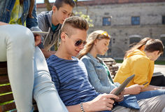 Group of students with tablet pc at school yard Royalty Free Stock Photography