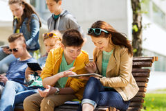 Group of students with tablet pc at school yard Stock Photo