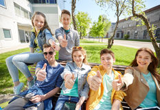 Group of students with tablet pc at school yard. Education, high school and people concept - group of happy teenage students with tablet pc computers at campus Stock Image