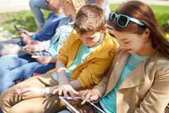 Group of students with tablet pc at school yard Stock Photos