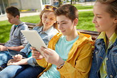 Group of students with tablet pc at school yard Royalty Free Stock Photos