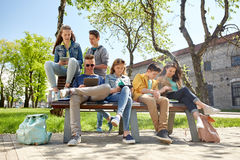 Group of students with tablet pc at school yard Royalty Free Stock Image