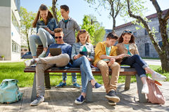 Group of students with tablet pc at school yard. Education, high school and people concept - group of happy teenage students with tablet pc computers at campus Royalty Free Stock Photos