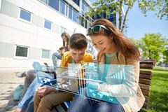 Group of students with tablet pc at school yard. Education, technology and people concept - group of happy teenage students with tablet pc computers at school Royalty Free Stock Images