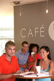 Group of students taking a coffee break Royalty Free Stock Image