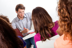 Group of students taking part in lecture Stock Photos