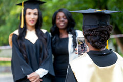Group of students taking a picture. In their graduation Stock Photography