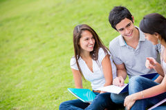 Group of students talking outdoors Royalty Free Stock Photos