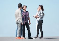 Group of students talking while standing outdoors Royalty Free Stock Photos