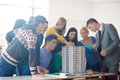 Group of students with teacher on class Stock Images