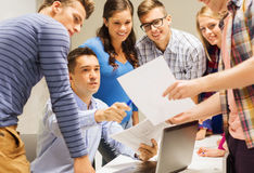 Group of students and teacher with laptop Stock Photos