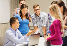 Group of students and teacher with laptop Royalty Free Stock Images