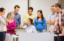 Group of students and teacher with laptop Stock Image