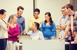 Group of students and teacher with laptop Royalty Free Stock Image
