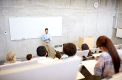 Group of students and teacher at lecture Royalty Free Stock Photography