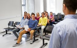 Group of students and teacher at lecture hall stock photos