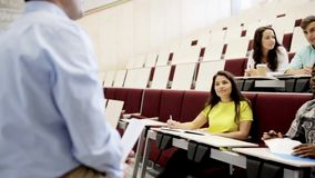 Group of students and teacher in lecture hall stock video