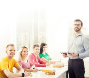 Group of students and a teacher at the lesson Stock Photography