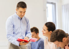 Group of students and teacher with notebook Stock Photos