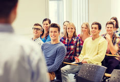 Group of students and teacher with notebook Royalty Free Stock Photography