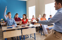 Group of students and teacher with papers or tests Royalty Free Stock Images
