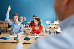 Group of students and teacher with papers or tests Royalty Free Stock Image