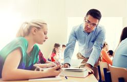 Group of students and teacher at school classroom Stock Image