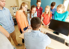 Group of students and teacher at school Royalty Free Stock Photography