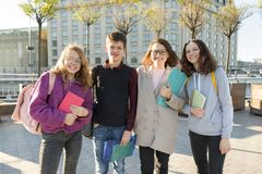 Group of students with teacher, teenagers talking to a female teacher royalty free stock photos