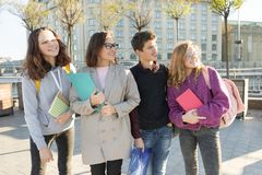Group of students with teacher, teenagers talking to a female teacher royalty free stock image