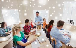 Group of students and teacher with test results Royalty Free Stock Image