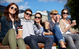 Group of students or teenagers drinking coffee Royalty Free Stock Photo