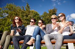 Group of students or teenagers drinking coffee Royalty Free Stock Image