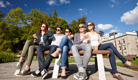 Group of students or teenagers drinking coffee Royalty Free Stock Photography