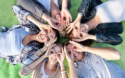 Group of students or teenagers lying in circle Stock Image