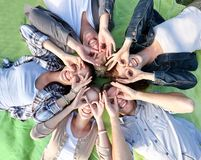Group of students or teenagers lying in circle. Summer holidays, friendship, leisure and teenage concept - group of students or teenagers lying in circle and Royalty Free Stock Images