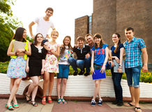 Group of students or teenagers with notebooks outdoors Royalty Free Stock Image