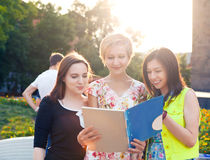 Group of students or teenagers with notebooks outdoors Stock Photography