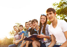 Group of students or teenagers with notebooks outdoors Royalty Free Stock Photos