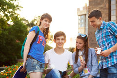 Group of students or teenagers with notebooks outdoors Stock Images
