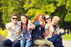 Group of students or teenagers showing thumbs up Royalty Free Stock Photo