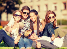 Group of students or teenagers showing thumbs up Stock Image