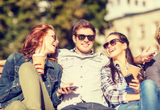 Group of students or teenagers with smartphones Royalty Free Stock Photos