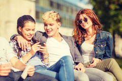 Group of students or teenagers with smartphones Stock Photos