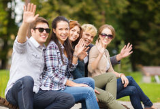 Group of students or teenagers waving hands Royalty Free Stock Images