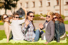Group of students or teenagers waving hands Stock Photography