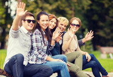 Group of students or teenagers waving hands Stock Photos